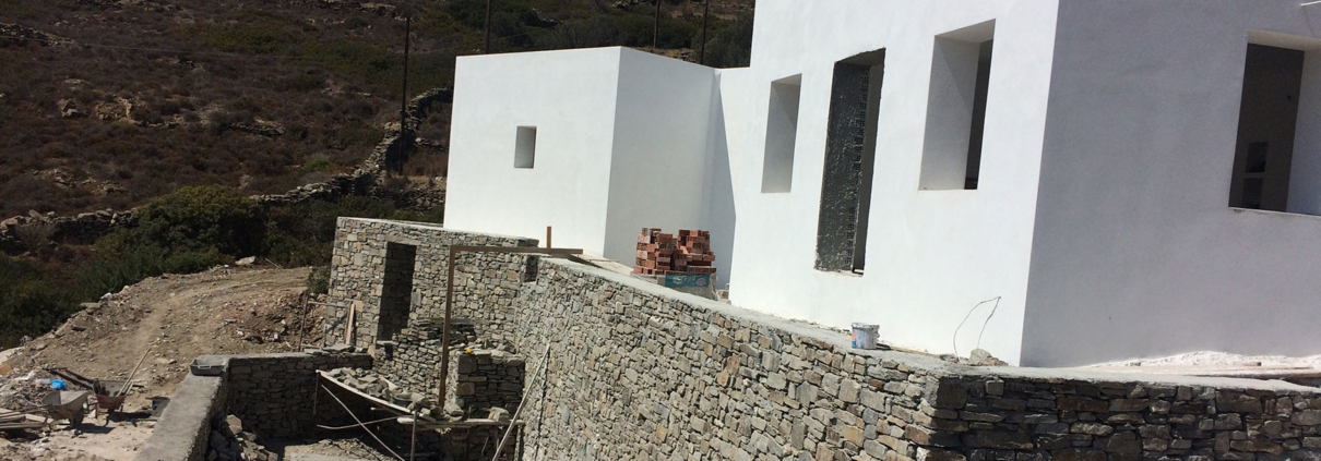 White plastered wall on a stone structure, which magically melts in the environment